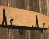 hat rack made from reclaimed wine barrel stave three hooks