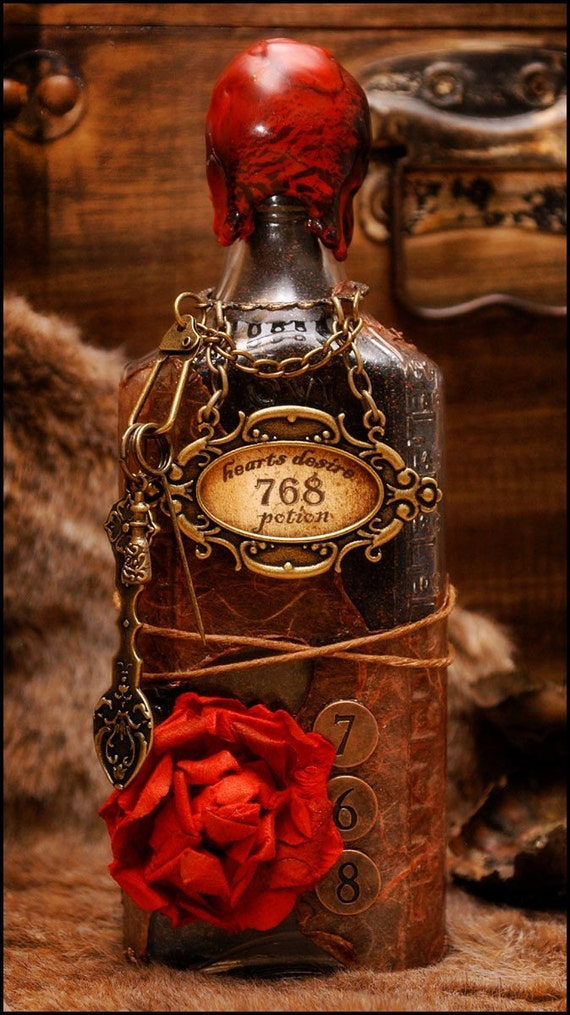 SALE  Hearts Desire Love Potion Vintage Bottle  Steampunk Style Embellished with Chains and Charms Witchcraft Decoration OOAK