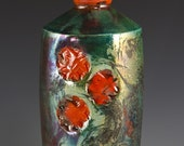 Green metallic raku bottle vase with cherry red accents