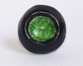 Black porcelain ring with green crystal and sterling silver base ring