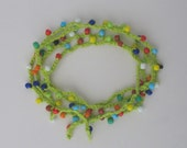 Colorful crocheted necklace / bracelet with delicate beads