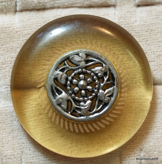 Large vintage Bakelite or catalin applejuice  button with silver decorative attached center