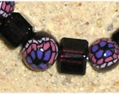 pink and purple floral bracelet with burgundy glass beads