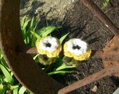 Pair of yellow and off white colored crochet flower barrettes