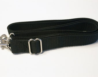 Adjustable, Detachable Strap - approximately 29-57 inches