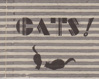 "Cats--An illustrated book of quotations by famous authors. Sample: ""The dog did it."""