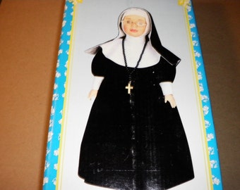 Vintage Porcelain Nun Doll With Rosary, Glasses, and Stand, 1970s