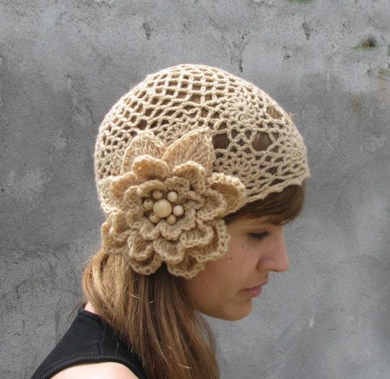 Crochet hat with large crochet flower