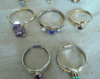 Eight Gold Tone Vintage Adjustable Rings