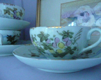 Vintage Transparent China Cups and Saucers 5 cups and 6 saucers