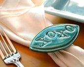 Set of Four Ready To Ship XOXO Napkin Rings by Symmetrical Pottery