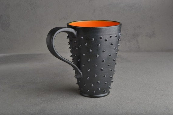 Spiky Mug: Black and Orange Dangerously Spiky Travel Mug by Symmetrical Pottery