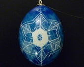 Hanging pysanka egg, blue with white snowflake
