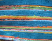 handwoven rag rug, tropical paradise, deep turquoise and sunset colored strips.  Playful, colorful and happy