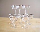 8 Dorothy Thorpe style silver rim stemmed glasses