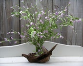 Lavender wildflowers on driftwood base