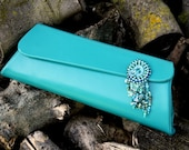 Blue Lagoon Leather with embroidered oval decoration pochette