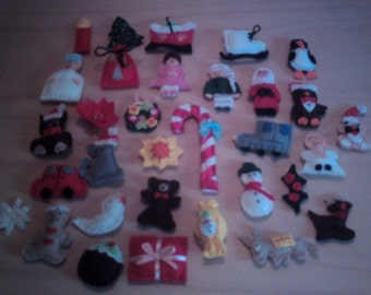 32 hand made felt Christmas ornaments.