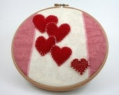 Valentines Day embroidery hoop art, cascading red hearts, love, round frame, red felt, rasperry pink, cream recycled fabric, beaded heart