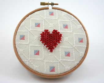 Valentines Day embroidery hoop art, red beaded heart, recycled cream fabric circle, round wall decor, red beads, blue, salmon pink, squares