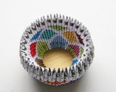 A unique, colorful, folded-paper bowl
