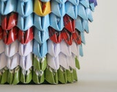 Origami pencil holder with a pastoral village pattern