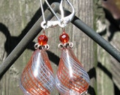 Light and lovely handblown orange and blue striped teardrop glass earrings.