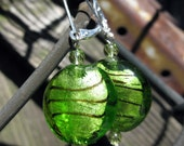 Shimmering green foil-lined glass earrings