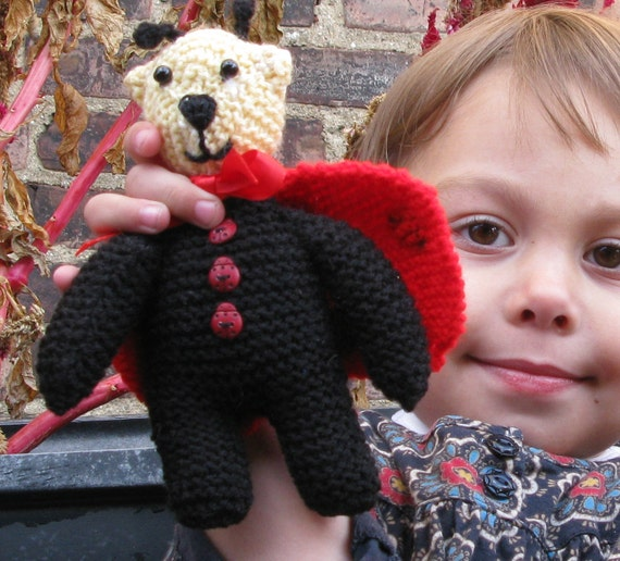 Ladybug Bear with red-spotted wings and antenna.