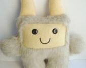 Furry plush monster in yellow fleece- Imani the calm monster