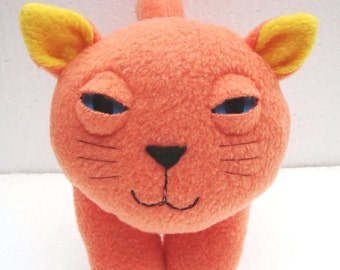 stuffed animal plush kitty cat in orange and yellow fleece - feathers