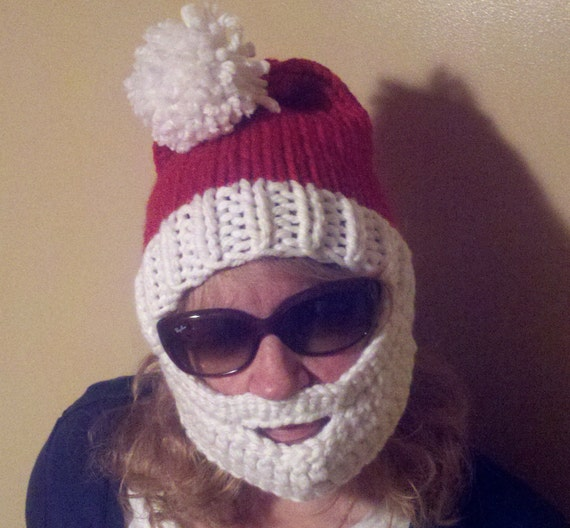 Slide on the Santa Beardo Beard Hat and you will undoubtedly be sporting the most amazing winter accessory known to man. The hand made, % acrylic yarn red beanie (with white puff ball!) features a one-size-fits-all white detachable beard.
