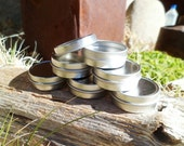 Set of 10- 1 OZ  Flat Tins with lids with shrink bands.  Ready to fill.