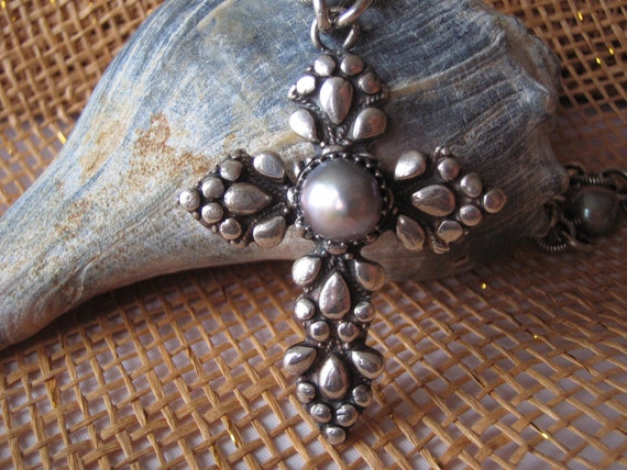 Sterling silver necklace with fresh water pearls, natural crystals, and a cross handmade of fine 999 silver. Urban Jewelry Collection