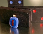 Fused glass pendant . cobalt blue with small red circles