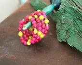 pink and lime green acai seed memory wire bracelet