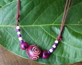 carved Tagua Nut with acai seeds adjustable necklace