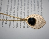 Gold plated chain and leaf pendant with a gold wrapped black faceted glass drop