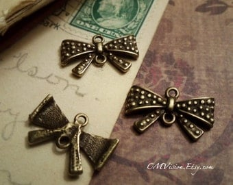 10pc of  Antiqued Bronze Lovely 50s Polka Dotted Bow Connector J30-Rd