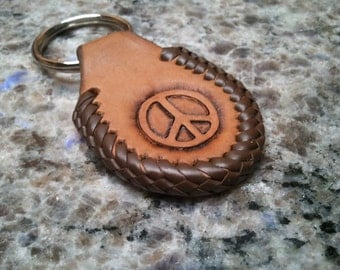 PEACE symbol keychain, doublesided, hand stamped in leather with leather lacing and heavy duty ring