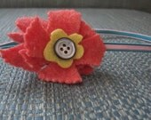 Orange and yellow felted flower with button on elastic headband