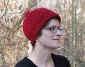 Red knit hat with pom pom-adult