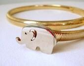 vintage 1970s baby elephant slim stretch disco belt skinny gold tone elastic link metal