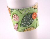 Fabric Coffee Sleeve  Green with Orange, Pink and Yellow Leaves