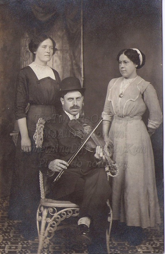 Vintage Photograph real photo postcard of a family and a violin