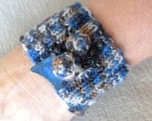 Knitted Cuff  from Blue variegated Yarn and Beads
