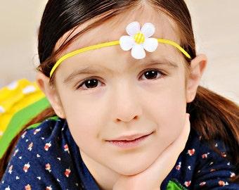 white felt daisy on yellow skinny headband