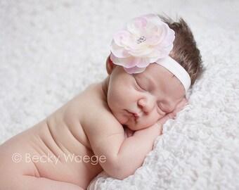 pink silk flower on stretchy pink headband