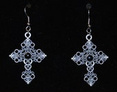 Pewter tone cross dangle earrings with black accents and intricate details