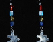 Autism Awareness dangle earrings with medium size red, yellow and blue beads and medium size silver tone puzzle piece